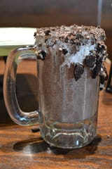 Wahlburgers serves adult frappes. The mud pie is made with coffee ice cream, Pinnacle vanilla vodka,  creme de cocoa, Kahlua, vanilla frosting and crushed Oreo pieces.