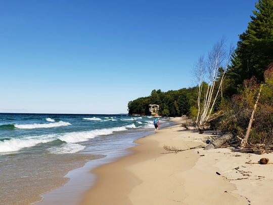 Chapel Beach and Chapel Rock, on its eastern end, are a popular stop for visitors to Pictured Rocks National Lakeshore on Sept. 14, 2019.