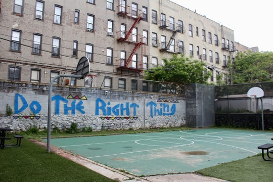 Young people have time to play basketball or hang out outside as part of their daily schedule at the Close to Home facility in Brooklyn, New York.