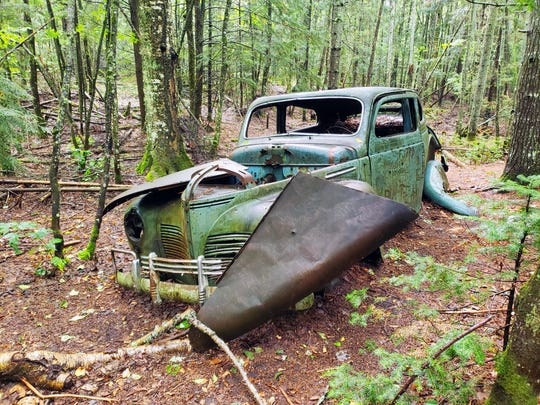 An old car sits abandoned off the North Country Trail in the Beaver Basin Wilderness in Pictured Rocks National Lakeshore on Sept. 13, 2019.