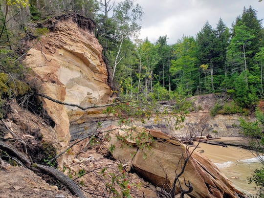 A slab of sandstone sits below the cliff it fell from in Pictured Rocks National Lakeshore on Sept. 14, 2019.