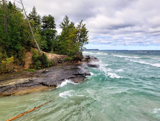 Lake Superior waves crash against the rocky shoreline of Pictured Rocks National Lakeshore on Sept. 14, 2019.