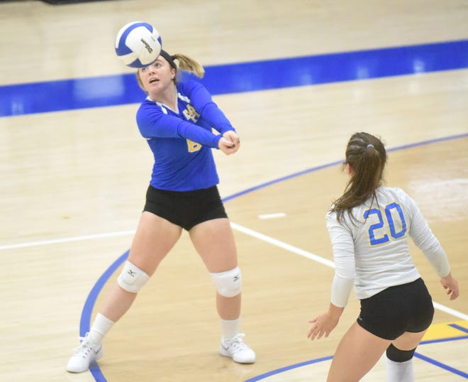 Mountain Home's Riley Straka passes during a recent match at The Hangar as teammate Elaine Blackmon looks on.