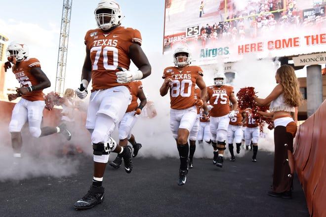 Aug 31, 2019; Austin, TX, USA; Texas Longhorns take the field before a game against the Louisiana Tech Bulldogs at Darrell K Royal-Texas Memorial Stadium. Mandatory Credit: Scott Wachter-USA TODAY Sports