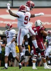 Alabama defensive back Jordan Battle (9) and defensive lineman Raekwon Davis (99) celebrate a stop against South Carolina at Williams-Brice Stadium in Columbia, S.C., on Saturday September 14, 2019.