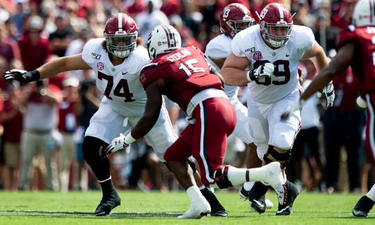 Alabama offensive linemen Jedrick Wills, Jr., (74) and Landon Dickerson (69) block against South Carolina at Williams-Brice Stadium in Columbia, S.C., on Saturday September 14, 2019.
