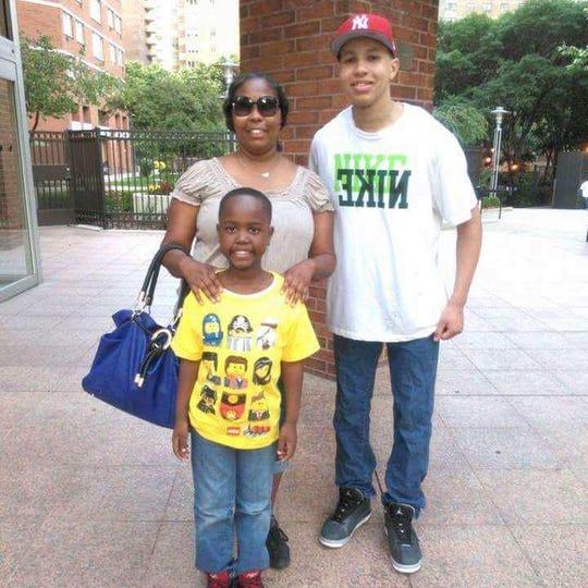 Jamari Terrell Williams with his mother, Monique Davis, and older brother, Brandon Muniz.