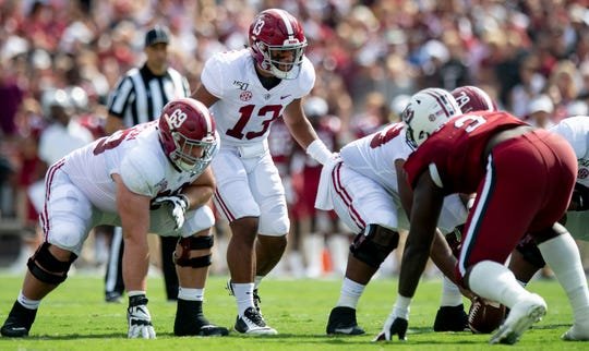Alabama quarterback Tua Tagovailoa (13) talks with his linemen, including Landon Dickerson (69) against South Carolina at Williams-Brice Stadium in Columbia, S.C., on Saturday September 14, 2019.