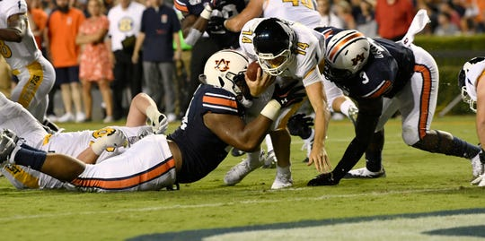 Auburn's Tyrone Truesdell (left) and Marlon Davidson (right) sack Kent St quarterback Dustin Crum on Saturday, Sept. 14, 2019 in Auburn, Ala.