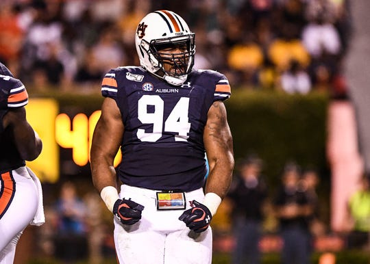 Auburn defensive tackle Tyrone Truesdell (94) celebrates after making a play against Kent State on Saturday, Sept. 14, 2019, in Auburn, Ala.