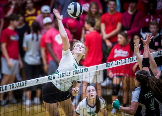 New Castle's Mabrey Shaffmaster hits against Yorktown during their game at New Castle High School Tuesday, Sept. 17, 2019.
