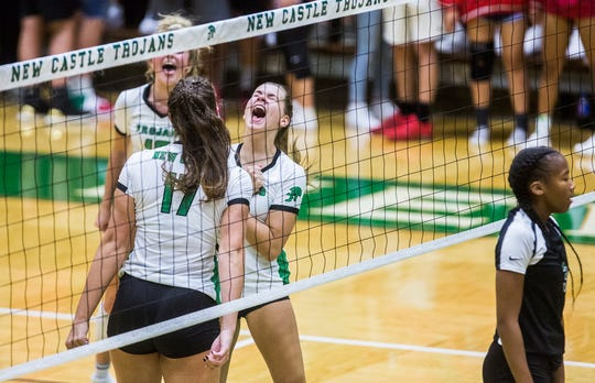 FILE -- New Castle celebrates a point against Yorktown during their match at New Castle High School on Sept. 17, 2019.