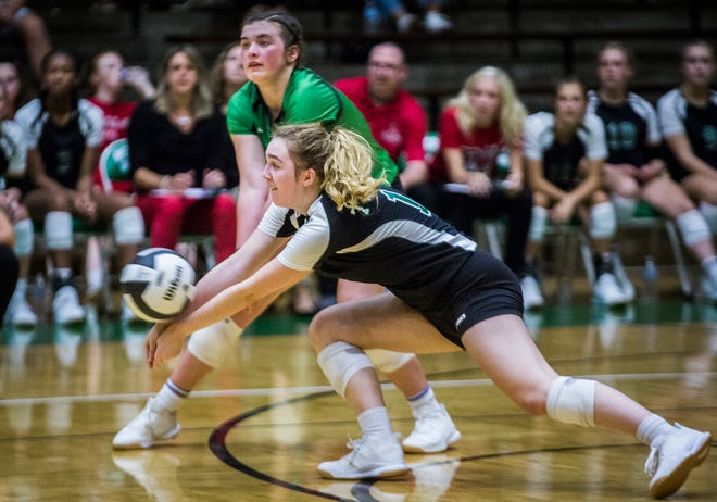 FILE -- Yorktown's Rory Powers digs a ball in the 2019 sectional semifinal match against New Castle at New Castle High School Tuesday, Sept. 17, 2019.