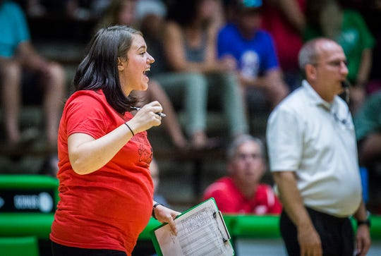 FILE -- New Castle head coach Sarah Roush instructs her team during its match against Yorktown at New Castle High School on Sept. 17, 2019.