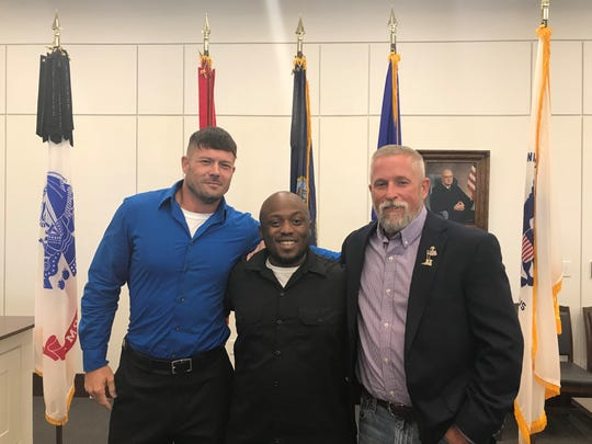 Veterans Justin Stiles, Matthew Lockett and William Truesdell pose after their graduation from veteran's recovery court on Wednesday, Sept. 18, 2019.