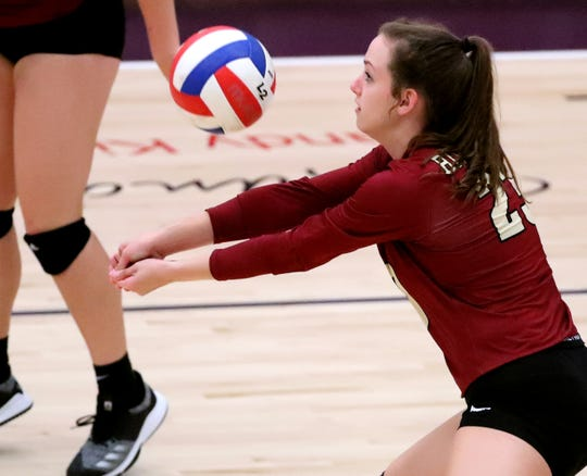 Riverdale's Ella Haney (23) hits the ball during the game against Oakland on Tuesday Sept. 17, 2019 at Oakland.