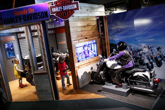 "Kids can go for a virtual test drive at the Discovery Center's latest exhibit, ""Hands-On Harley-Davidson."""