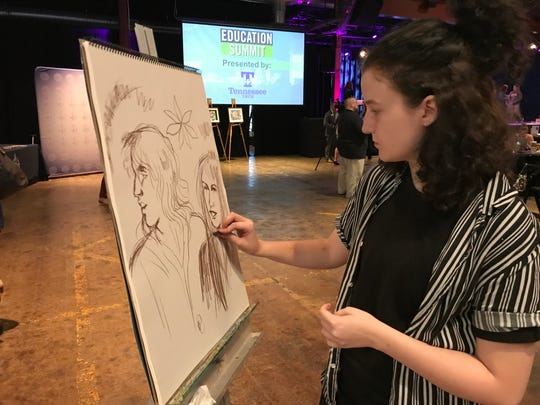 The Williamson Inc. Education Summit didn't forget the importance of the arts Tuesday. Louie Pecce, a senior at Summit High School, works on a piece during the summit at The Factory at Franklin Tuesday.