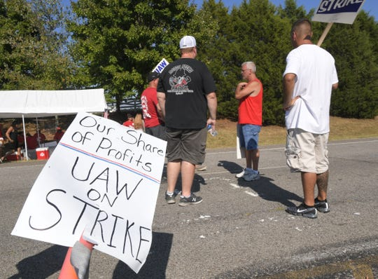 Striking workers protest outside the south gate of the General Motors plant Wednesday, Sept. 18, 2019, in Spring Hill, Tenn.