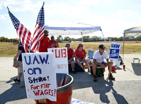 Striking workers protest outside the north gate of the General Motors plant Wednesday, Sept. 18, 2019, in Spring Hill, Tenn.