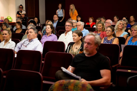 Community members listen as Linda Flynn, partner and research director with the Cultural Planning Group, speaks during a community forum on arts and culture in Collier County at the Collier County library headquarters in Naples on Tuesday, September 17, 2019.
