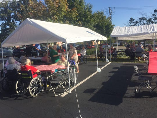 Residents dined in tents set up in the parking lot and on the front lawn of Pataskala Oaks, in the same spots to which they were evacuated on July 29.