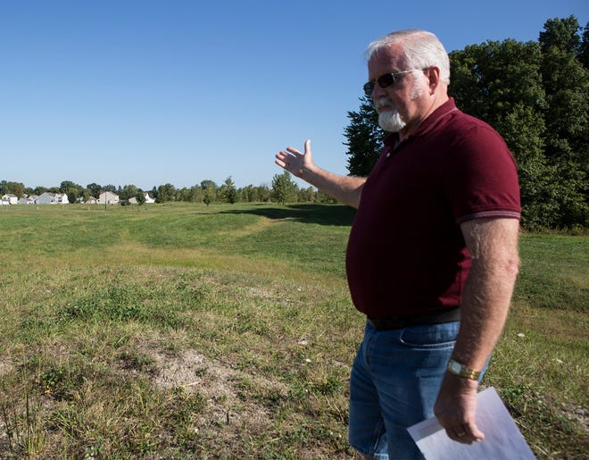 Hebron resident Wayne Carruthers points to an empty field behind his home that has been designated as empty lots on the Licking County tax map. Carruthers and his wife, Nelva, expressed concerns over paying an annual fee to their Homeowners' Association, who they say doesn't properly maintain the Lake Forest subdivision.
