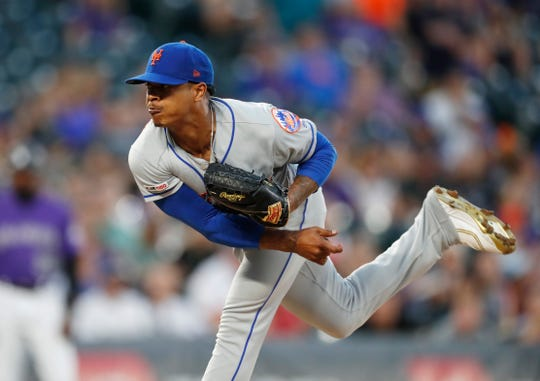 New York Mets starting pitcher Marcus Stroman works against the Colorado Rockies during the first inning of a baseball game Tuesday, Sept. 17, 2019, in Denver. (AP Photo/David Zalubowski)