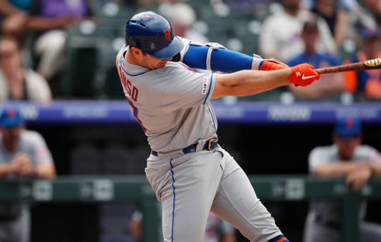 New York Mets' Pete Alonso connects for a solo home run off Colorado Rockies starting pitcher Jeff Hoffman in the sixth inning of a baseball game Wednesday, Sept. 18, 2019, in Denver.