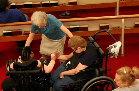 Alice Smyser and two people in wheelchairs meet during the 25th anniversary service of Friends to Friends Community Church, in Ridgewood. Friends to Friends is believed to be the only church in New Jersey where the congregation is made up, mostly of people with physical or developmental disabilities. Sunday, September 15, 2019