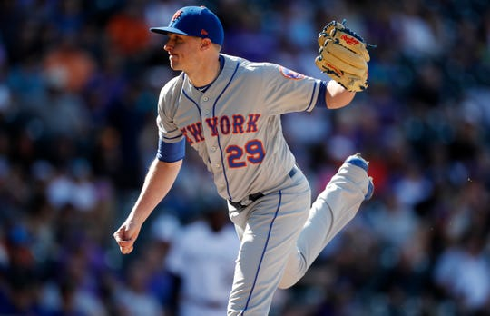 New York Mets relief pitcher Brad Brach works against the Colorado Rockies in the seventh inning of a baseball game Wednesday, Sept. 18, 2019, in Denver.