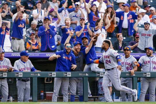 Sep 18, 2019; Denver, CO, USA; New York Mets second baseman Robinson Cano (24) celebrates with teammates after a play in the ninth inning against the Colorado Rockies at Coors Field.