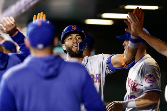 Sep 17, 2019; Denver, CO, USA; New York Mets shortstop Amed Rosario (1) celebrates in the dugout after hitting a two run home run in the sixth inning against the Colorado Rockies at Coors Field. Mandatory Credit: Isaiah J. Downing-USA TODAY Sports