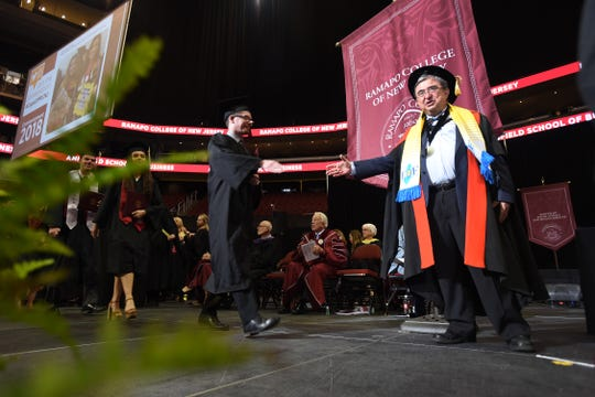 Peter P. Mercer, Ramapo College president, greets each graduate after they receive their diplomas on the stage during the Ramapo College commencement at Prudential Center in Newark on 05/10/18.