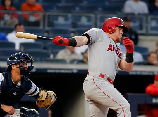 Sep 18, 2019; Bronx, NY, USA; Los Angeles Angels right fielder Kole Calhoun (56) singles against the New York Yankees during the first inning at Yankee Stadium. Mandatory Credit: Andy Marlin-USA TODAY Sports