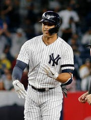 Sep 18, 2019; Bronx, NY, USA; New York Yankees left fielder Giancarlo Stanton (27) reacts after hitting a double against the Los Angeles Angels during the second inning at Yankee Stadium. Mandatory Credit: Andy Marlin-USA TODAY Sports