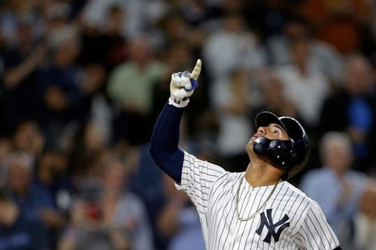 Sep 17, 2019; Bronx, NY, USA; New York Yankees second baseman Gleyber Torres (25) celebrates after hitting a three run home run against the Los Angeles Angels during the fourth inning at Yankee Stadium. Mandatory Credit: Adam Hunger-USA TODAY Sports