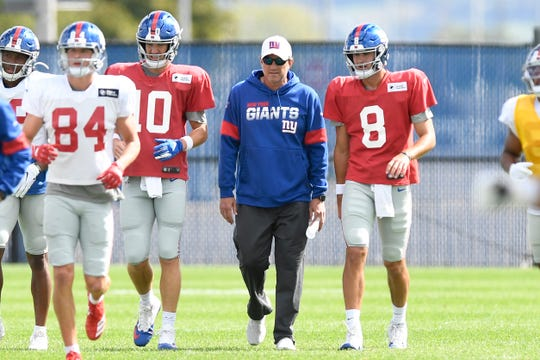 New York Giants quarterbacks Eli Manning (10) and Daniel Jones (8) work with offensive coordinator Mike Shula, center, during practice on Wednesday, Sept. 18, 2019, in East Rutherford. The Giants named Jones the starting quarterback against the Tampa Bay Buccaneers this Sunday.