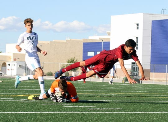 Junior Wildcat Leo Barajas leaps over the Onate goal keeper on a Deming scoring attack. The Wildcats surrendered three second-half goals in a 3-1 loss to the visiting Knights on Tuesday.