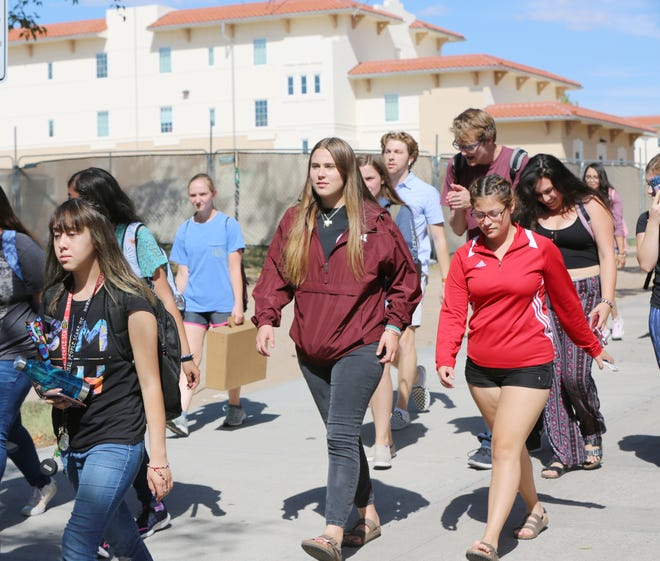 New Mexico State University students walk between classes Wednesday, Sept. 18, 2019. On Wednesday, New Mexico Gov. Michelle Lujan Grisham proposed New Mexico residents receive free education at state-funded institutions of higher learning.