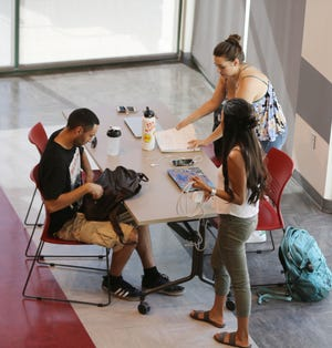 New Mexico State University students pack up after a study session at Corbett Center Student Union on Wednesday, Sept. 18, 2019.