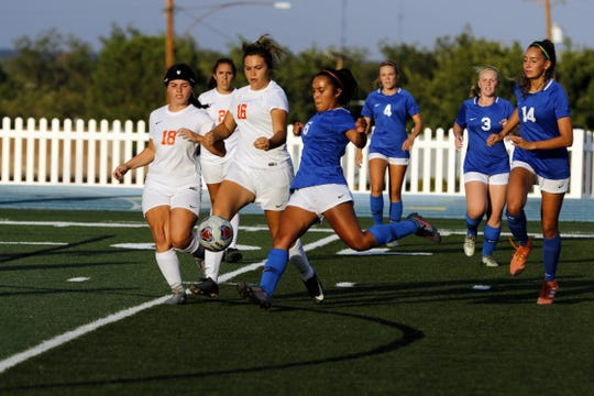 Carlsbad's Dominique Chacon loads up for a shot in the first half of Tuesday's match against Artesia. Carlsbad won, 4-0.