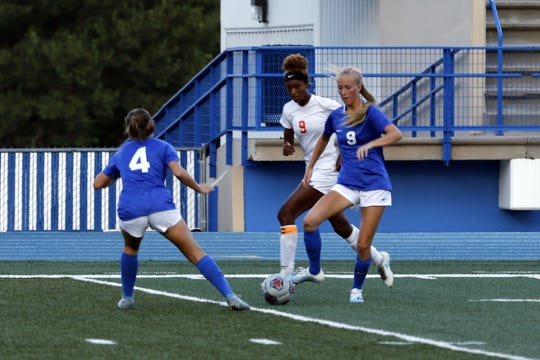 Artesia's Sadi Butler and Carlsbad's Jessica Munro battle for the ball during their match on Sept. 17, 2019. Carlsbad won, 4-0.