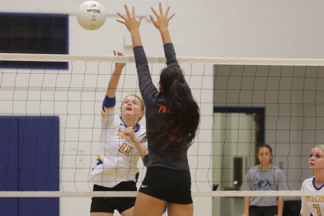 Bloomfield's Kailyn Gunn hits the ball into the right corner against Montezuma-Cortez's Avery Wright during Tuesday's volleyball match at Bobcat Gym in Bloomfield.