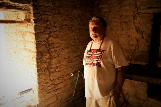 Researcher Fred Blackburn stands inside one of the rooms in the West Ruin at Aztec Ruins National Monument where he is conducting a survey of historic inscriptions.