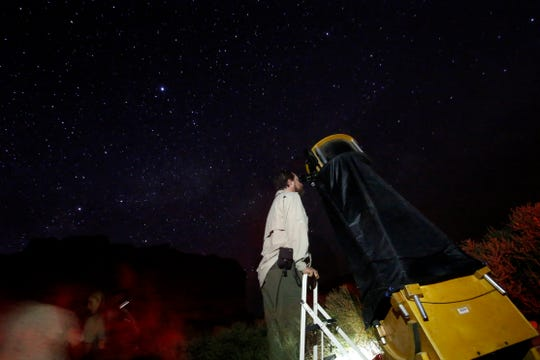 Don Emerson of Austin, Texas, looks through a telescope during a Chaco Night Sky program June 24, 2016, at Chaco Culture National Historic Park.