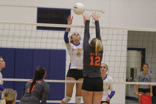 Bloomfield's Katie Waresback sends the ball over the net past Montezuma-Cortez's Amber Fuller (12) during Tuesday's volleyball match at Bobcat Gym in Bloomfield.