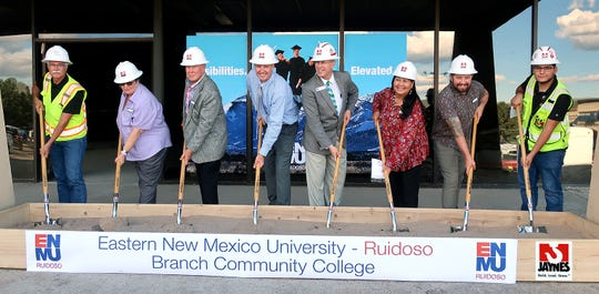 Members of ENMU-Ruidoso's Advisory Board, grab shovels for the groundbreaking of Phase I renovation of the campus. From left are Marla Romero, James Paxton, Brad Treptow, College President Dr. Ryan Carstens, Gina Klinekote and Justin Huffmon.