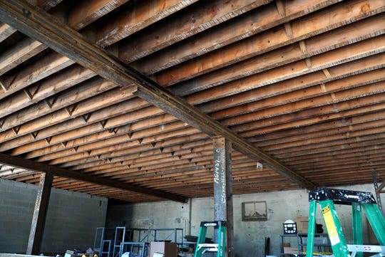 The main factory building at the corner of Cherry Hill and Ridge Road, was built by Henry Ford and utilized as a factory for auto parts. It still has most of its main structure including this flooring and truss system using northern Michigan lumber.