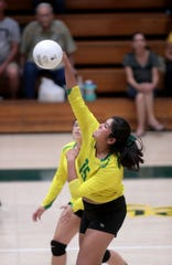 Coachella Valley's Cheyenne Sandoval spikes the ball during the match against Indio High in Thermal on Tuesday, September 17, 2019.